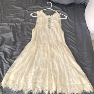 Lace cream colored backless dress by Free People